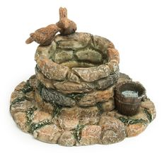 Fairy Wishing Well A pair of birds perch on this adorable wishing well, a great addition to any terrarium or fairy garden. pair of birds perch on this adorable wishing well, a great addition to any terrarium or fairy garden. Fairy Garden Furniture, Fairy Garden Supplies, Fairy Garden Houses, Fairies Garden, Garden Pond, Gardening Supplies, Terrarium, Fairy Village, Fairy Crafts