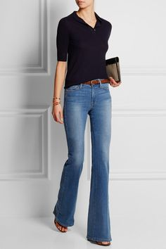 I have the items in my closet to style this -  black collared shirt, light wash flare jeans