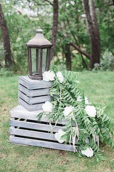 Crates, lanterns, and cascading florals make for stunning wedding decor