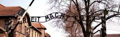 The 'Arbeit macht frei' sign over the main gate of the Auschwitz I camp.
