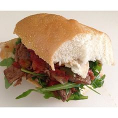 My version of Chicago style Italian beef hoagie- #arugula #provolone #beef #tomato #peppers #rolls