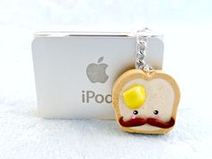 Kawaii Mustache Toast Dust Plug Charm, For iPod or iPhone :D. $5.00, via Etsy.