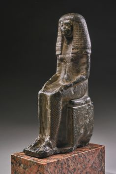 An Egyptian Steatite Figure of the Lady Iset, Chantress of Sobek, 19th Dynasty, Reign of Ramesses I/early in the Reign of Ramesses II, circa 1292-1250 B.C. | lot | Sotheby's
