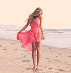 Sun kissed skin....windblown hair...pink high low dress, perfect beach combo