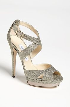 Jimmy Choo 'Kayak' Sandal. A metallic platform perfects the understated curves of a sparkle-struck criss-cross sandal.