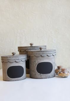 Country Kitchen Canister Set Charming and vintage inspired, these canisters feature a scalloped lid, antiqued details, and a chalkboard label.