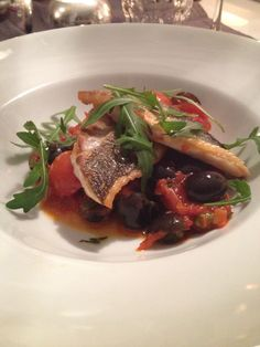 Baked seabass with a tomatosauce with capers, black olives and cherry tomatoes