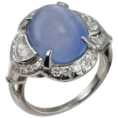 Art Deco Cabochon Sapphire Diamond Ring. A beautiful Art Deco cabochon sapphire ring set in platinum with two side half moon diamonds, which total approximately 0.30cts of diamonds along with 26 additional small round diamonds totaling approximately 0.50cts of diamonds, circa 1930s.