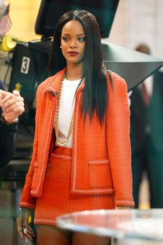 Gorgeous Rihanna in vintage Chanel blazer and skirt.