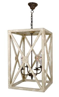 "This lantern's X design has timeless appeal. It features decorative medallions at the intersecting lines on all four sides.  Height 26"" Width 16.5"" Depth 16.5"""