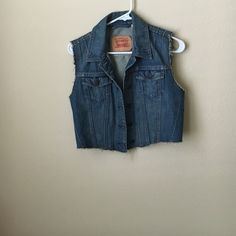 Denim Levis vest size small. cutup Denim Levis vest size small.. Worn once. Purchased off another seller. In excellent condition. Small stain    shown in pic. This I believe was a jacket cut to a vest. Levi's Jackets & Coats Vests