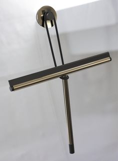 Our NOVA2 Shower Wiper hanging from our NOVA2 Suction hook