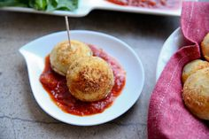 Two-Cheese Ebelskivers with Marinara Dipping Sauce: filled with Parmesan cheese, basil, and mozzarella cheese; dipped in your favorite marinara sauce