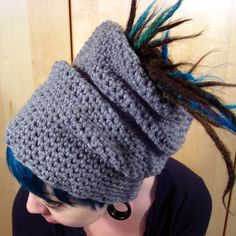 This cozy hat is fully adjustable to allow you to tuck your dreads in like our traditional Softie Hat or let them fly free while still keeping your ears and head warm and cozy. Made of 100% Polyester.    As Always, the Knot-Top Tube Hats are handmade locally and designed specifically for Knotty Boy!