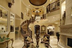 Traditional Staircase with limestone floors & Wainscoting in Boca Raton, FL | Zillow Digs