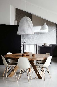 The color scheme—my favorite palette ever—is a calm mix of black, white and gray with the perfect touch of wood accents like the Mark Tuckey 'Tripod' dining table. Simply divine!