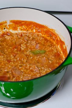 jambalaya - this recipe is from Paula Deen's Southern Cooking Bible. I made it without the tomatoes (just tomato sauce) and without the shrimp, so I added extra sausage. The flavor was delicious, but I would add celery, onion, and green pepper to it next time! My husband says Paula Deen must be a fake not to include the holy trinity in her recipe. ;)