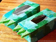 DIY dinosaur feet for kids using empty tissue boxes, tissue paper & sponges.