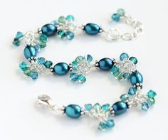 Deep Teal Cluster Bracelet with dark teal blue freshwater pearls, blue and green Swarovski crystals, and sterling silver. By OpheliasJewels, $54.00
