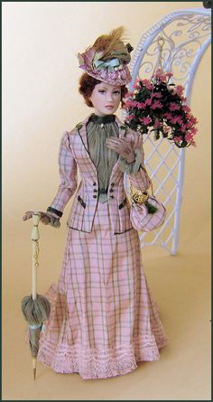 1900.  Her costume is made of checked silk taffeta,   with a silk chiffon blouse.