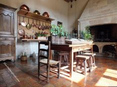 The kitchen at Château de Villandry is the only rustic room in the chateau with a terracotta tiled floor, large fireplace, etc. French Kitchen, Old Kitchen, Copper Kitchen, Rustic Kitchen, Kitchen Decor, Beautiful Kitchens, Beautiful Homes, Château De Villandry, Rustic Room