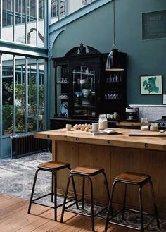 Coffee shop. Blue. Wood. Windows.