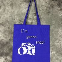 Hand painted blueberry bag with I'm Gonna Snap! design on it. Design is painted in silver on one side only. Perfect for Photographers, conventions, trips to the comic shop, as a reusable shopping bag or as a purse.  Blueberry (blueish purple) 100% cotton canvas promo bag (thinner than reg. canv...