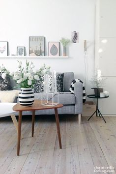 I like the grey couch, cushions and the different arrangement of pictures on the back wall.