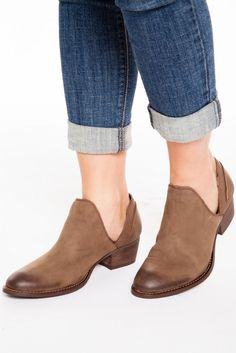 The Rebels Chris Ankle Bootie in Stone are those wear with everything shoes we can't get enough of! Genuine brown leather forms a two-tone pointed toe upper with top stitched welt and a cutout collar complete with a man made wood sole. #booties