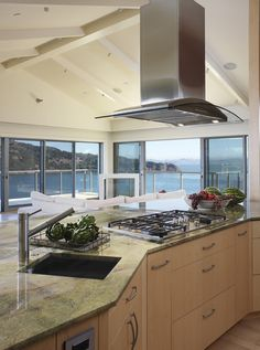 Island range hood ideas island hood stove and minimal - Kitchen island with cooktop and prep sink ...