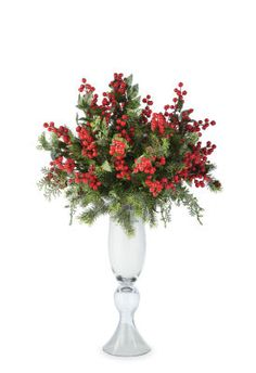 Frosted Foliage and Berries Arrangement  *Fill glass fluted urn with snow.  *Cut and secure foam to top of container with glue.  *Cover foam with snow and Spanish moss, mixed.  *Cut and insert berry bushes, and secure with glue.  *Cut and insert pine bushes, then secure with glue.