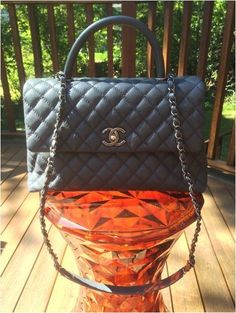 76fee6186b7d The Chanel Coco Handle Bag is an Hermes Kelly inspired dupe. However, can  the
