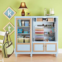 Dress up an entertainment cabinet to organize small quantities of scrapbook supplies while still staying stylish.