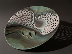 Clare Wakefield Ceramics - Large holed bowl in porcelain with waves and swirls