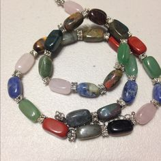 Bracelet and necklace gemstone set 18 inch total length gemstone necklace with stretchy gemstone bracelet. Includes rose Quartz, sodalite, red jasper, Tigers eye, amazonite and more Jewelry Bracelets