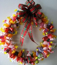 A Sutphin family tradition-Candy wreaths. This makes a fun, yummy gift for a neighbor or friend. Another way to do it is to make your form out of a wire clothes hanger, group 3 candies together and tie their wrapper ends together-leaving enough ribbon to tie onto your form. It makes for a colorful, tasty wreath:)