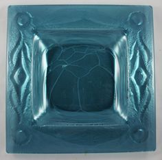 Handmade nz made glass platter. Reflective glass takes on a new look when it is slumped over a carved mold and fired in the kiln.