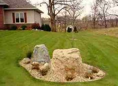 Septic access hidden by fake rocks. Keeps the yard looking great and you always know where your Septic access is!