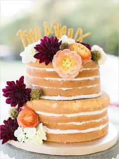 naked cake wedding cake with gold glittery cake topper