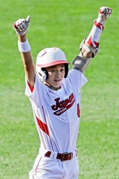 Tokyo, Japan's Dai Okada (4) celebrates after hitting a triple off Brno, Czech Republic pitcher Kukas Hlouch during the second inning of a game in International pool play at the Little League World Series in South Williamsport, Pa. Friday. (Gene J. Puskar/AP)