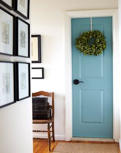 gallery wall with black frames - blue door