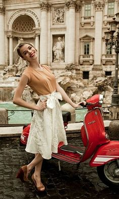 Two Italian icons in one frame, the Trevi Fountain and a Vespa