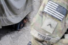 The 82nd in Afghanistan -- An Afghan boy watches a U.S. soldier from 5-20 infantry Regiment attached to 82nd Airborne on patrol in Zharay district in Kandahar province, April 26, 2012.   REUTERS/Baz Ratner