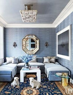 Michael Smith ~ walls—sheathed in a John Robshaw fabric—display an Italian mirror and a Hiroshi Sugimoto photograph; the ceiling fixture is by Mathieu Lustrerie, and the sectional sofa, in a Jasper silk mohair, is by Jonas.