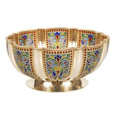 """IVAN KHLEBNIKOV Plique-a-jour Enamel Bowl Russia 1908-1917 A Russian silver gilt and plique-a-jour enamel bowl, Ivan Khlebnikov, Moscow, 1908-1917. Of shaped circular form on a flaring base, the body worked in fluted panels of scrolling foliate multi-color translucent enamel within bands of red enamel beads, the rim with twisted ropework border. Diameter: 5 1/2"""". Represented by: John Atzbach Antiques"""