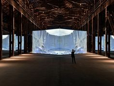 The Man Who Turns Buildings Into Giant Video Screens | Doug Aitken might be best known for his immersive multimedia installations (like this one, Altered Earth), but one of his most recent projects is as old-school as it gets: A book. Herve Hote | WIRED.com
