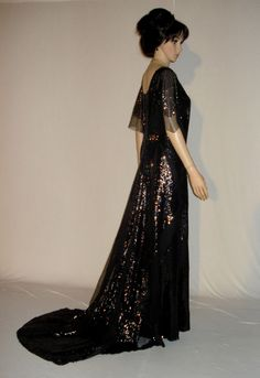This gown is covered almost entirely in black sequins with some smaller panels of netting. The gown is entirely backed with a heavy silk satin, except for the sleeves, which have a neutral colored chiffon silk under layer. | eBay!