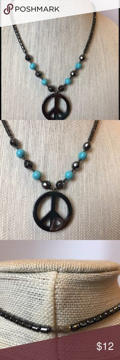 Gunmetal finish ☮️Necklace Cute little necklace with turquoise colored beads and dark gunmetal steel colored beads and peace sign. Like brand new. Jewelry Necklaces