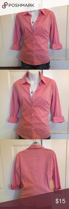 New York & company long sleeve button up New York &a company long sleeve button up. It is a salmon/pink coral color. Amazing condition no flaws. City stretch size medium. New York & Company Tops Button Down Shirts