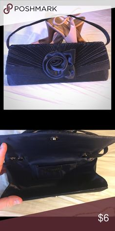 Navy Blue Purse Small navy blue clutch. This was used for less than an hour at a wedding. It comes with a long strap as well. It has a snap opening and one pocket on the inside. Perfect for a wedding clutch!! Bags Clutches & Wristlets